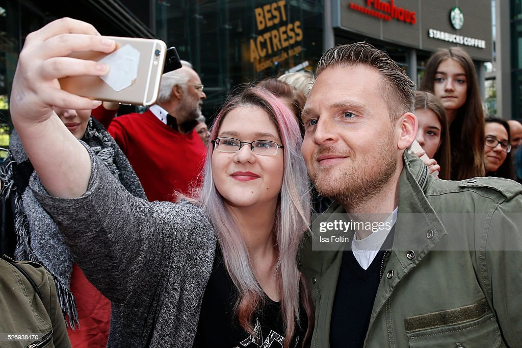 Actor Axel Stein with fans during the Berlin premiere of the film 'Angry Birds - Der Film' at CineStar on May 1, 2016 in Berlin, Germany.