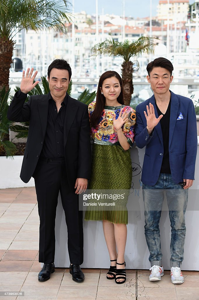 Actor Bae Sung-woo, actress Ko Ah-seong and director Hong Won-Chan attend the 'O Piseu' Photocall during the 68th annual Cannes Film Festival on May 19, 2015 in Cannes, France.