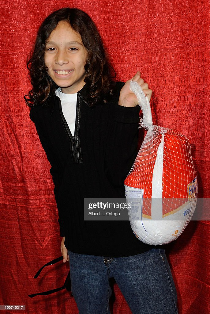Actor Bailey Garcia arrives for Jackson Limousine Homeless Turkey Drive Red Carpet Gala held at Infusion Lounge on November 19, 2012 in Universal City, California.