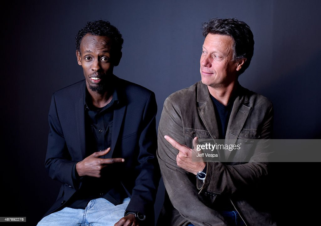 Actor Barkhad Abdi and director Gavin Hood from 'Eye In The Sky' pose for a portrait during the 2015 Toronto International Film Festival at the TIFF Bell Lightbox on September 12, 2015 in Toronto, Canada.