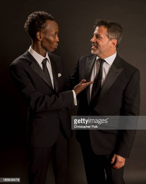 Actor Barkhad Abdi and producer Michael De Luca pose with the Hollywood Producer Award in the portrait studio during the 17th annual Hollywood Film...