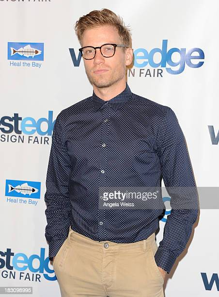 Actor Barrett Foa attends the WestEdge Design Fair opening night benefiting Heal the Bay at Barker Hangar on October 3 2013 in Santa Monica California