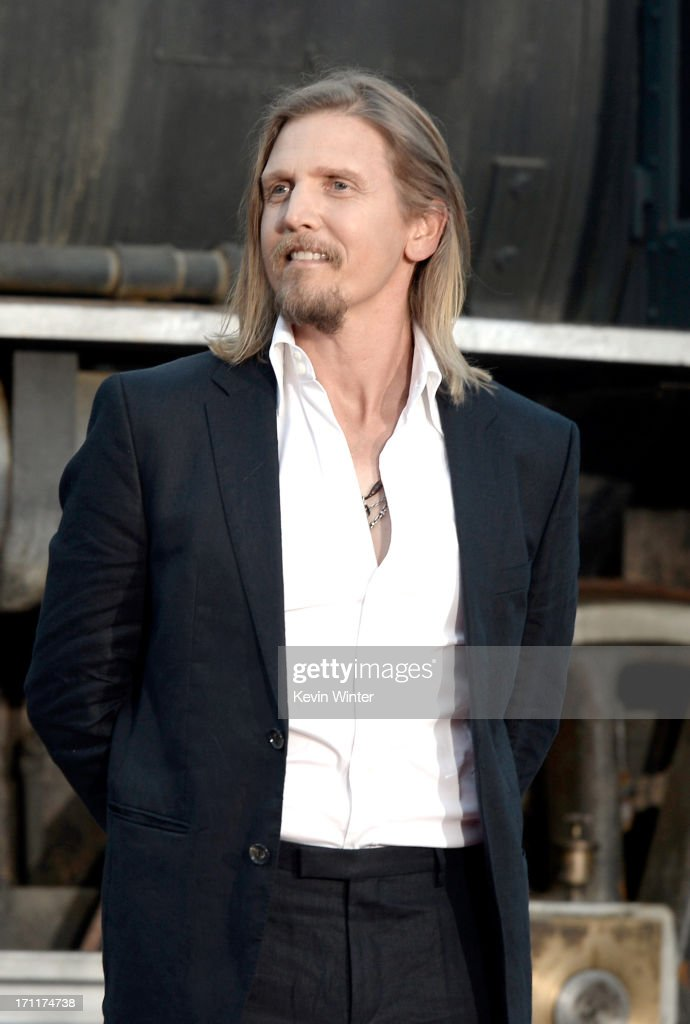 Actor <a gi-track='captionPersonalityLinkClicked' href=/galleries/search?phrase=Barry+Pepper&family=editorial&specificpeople=221726 ng-click='$event.stopPropagation()'>Barry Pepper</a> arrives at the premiere of Walt Disney Pictures' 'The Lone Ranger' at Disney California Adventure Park on June 22, 2013 in Anaheim, California.