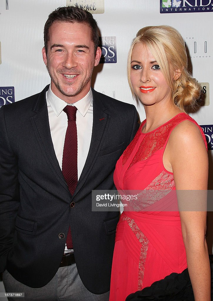 Actor Barry Sloane (L) and guest attend Mending Kids International's 'Four Kings & An Ace' Celebrity Poker Tournament at The London Hotel on December 1, 2012 in West Hollywood, California.