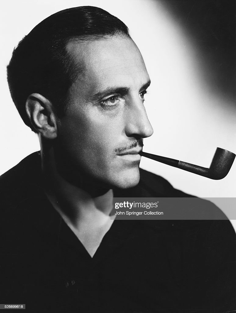 Actor <a gi-track='captionPersonalityLinkClicked' href=/galleries/search?phrase=Basil+Rathbone&family=editorial&specificpeople=93122 ng-click='$event.stopPropagation()'>Basil Rathbone</a> with Tobacco Pipe