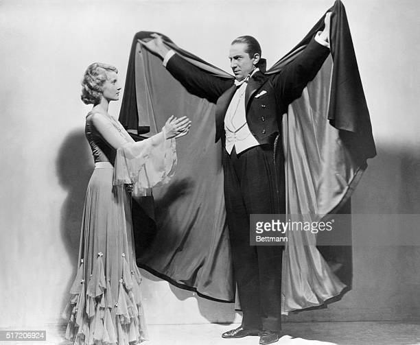 Actor Bela Lugosi draws in another pretty young victim as the Count himself in the horror classic Dracula