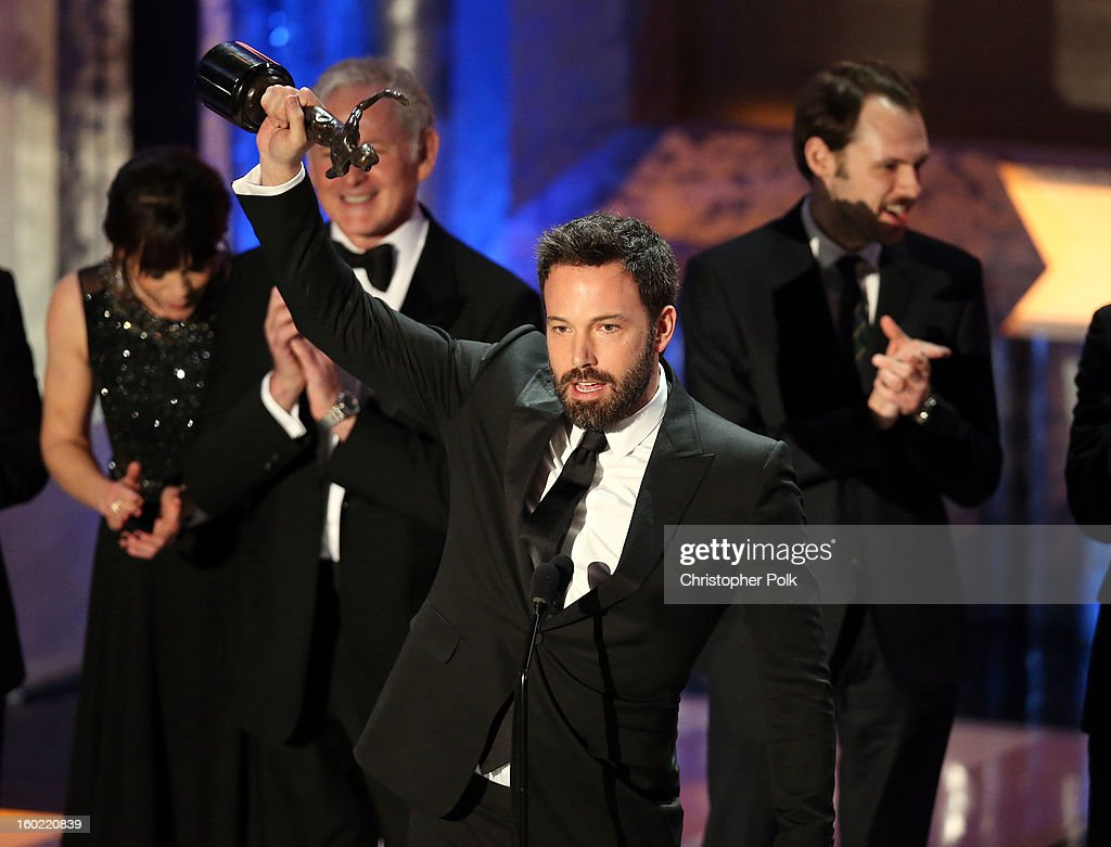 Actor <a gi-track='captionPersonalityLinkClicked' href=/galleries/search?phrase=Ben+Affleck&family=editorial&specificpeople=201856 ng-click='$event.stopPropagation()'>Ben Affleck</a> accepts the award for Outstanding Performance by a Cast in a Motion Picture for 'Argo' onstage during the 19th Annual Screen Actors Guild Awards at The Shrine Auditorium on January 27, 2013 in Los Angeles, California. (Photo by Christopher Polk/WireImage) 23116_012_2153.jpg