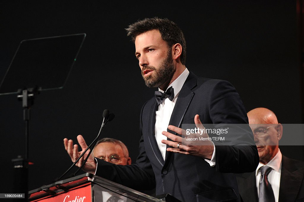 Actor <a gi-track='captionPersonalityLinkClicked' href=/galleries/search?phrase=Ben+Affleck&family=editorial&specificpeople=201856 ng-click='$event.stopPropagation()'>Ben Affleck</a> accepts the Ensemble Performance Award onstage during the 24th annual Palm Springs International Film Festival Awards Gala at the Palm Springs Convention Center on January 5, 2013 in Palm Springs, California.
