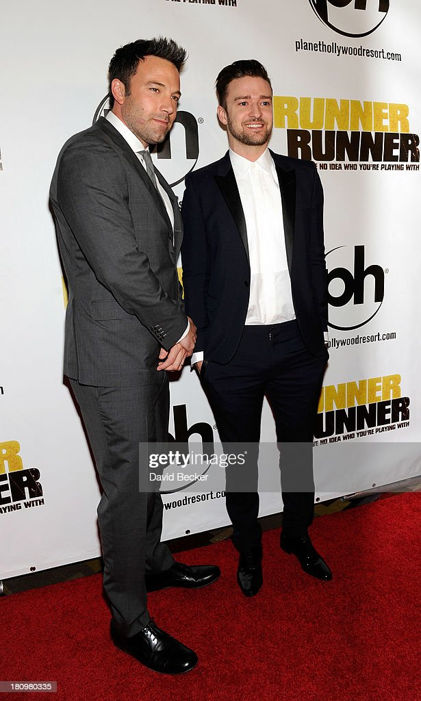 Actor Ben Affleck and singer/actor Justin Timberlake arrive at the world premiere of Twentieth Century Fox and New Regency's film 'Runner Runner' at...