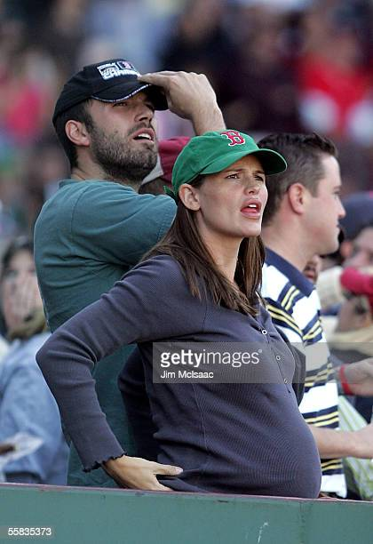 Actor Ben Affleck and wife actress Jennifer Garner watch the Boston Red Sox play the New York Yankees at Fenway Park on October 1 2005 in Boston...