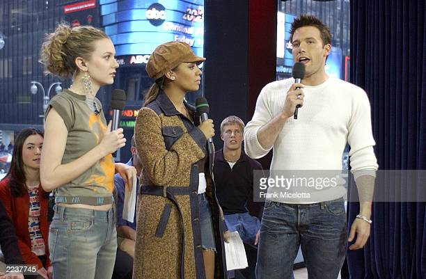 Actor Ben Affleck appears with VJ's Hilarie Burton and La La on MTV's 'TRL' at the MTV Times Square Studios February 13 2003 in New York City