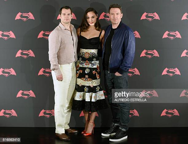 US actor Ben Affleck British actor Henry Cavill and Israeli actress and model Gal Gadot pose for photographers during a photocall of the new film...