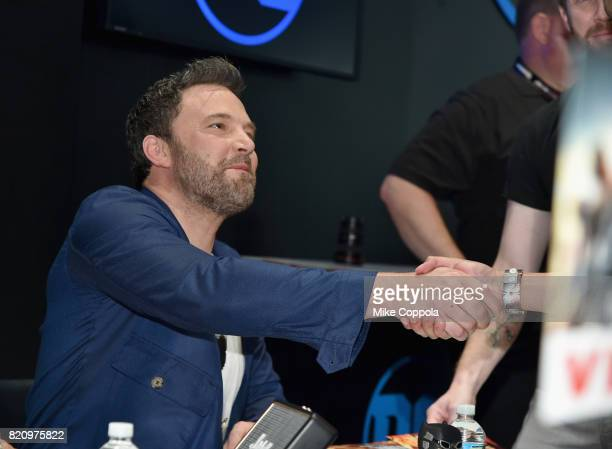 Actor Ben Affleck greets a fan during the 'Justice League' autograph signing at ComicCon International 2017 at San Diego Convention Center on July 22...
