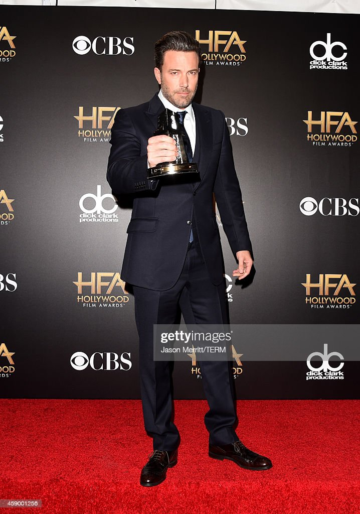 Actor Ben Affleck, winner of the Hollywood Film award for 'Gone Girl,' poses in the press room during the 18th Annual Hollywood Film Awards at The Palladium on November 14, 2014 in Hollywood, California.