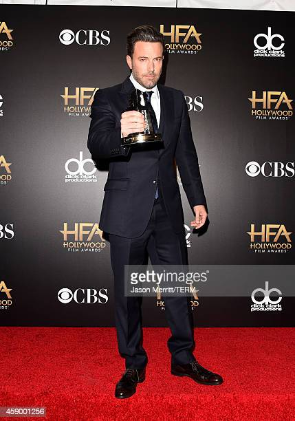 Actor Ben Affleck winner of the Hollywood Film award for 'Gone Girl' poses in the press room during the 18th Annual Hollywood Film Awards at The...