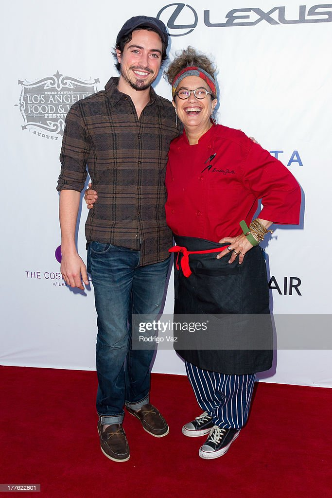 Actor Ben Feldman (L) and chef Susan Feniger attend LEXUS Live On Grand at the 3rd Annual Los Angeles Food & Wine Festival arrivals on August 24, 2013 in Los Angeles, California.