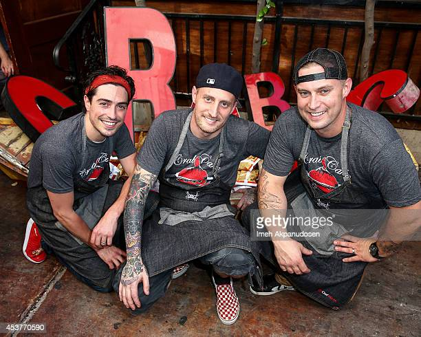 Actor Ben Feldman with chefs Michael Voltaggio and Bryan Voltaggio host Crab Cake 2014 presented by S Pellegrino Samsung Galaxy on August 17 2014 in...