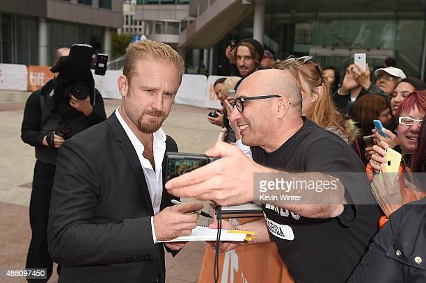 Actor Ben Foster takes a selfie with fans at 'The Program' premiere during the 2015 Toronto International Film Festival at Roy Thomson Hall on...