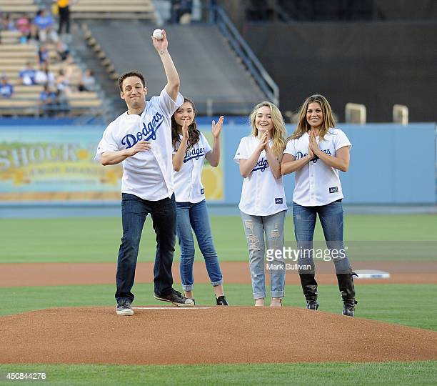 Actor Ben Savage throws out the ceremonial first pitch as fellow 'Girl Meets World' cast members Rowan Blanchard Sabrina Carpenter and Danielle...
