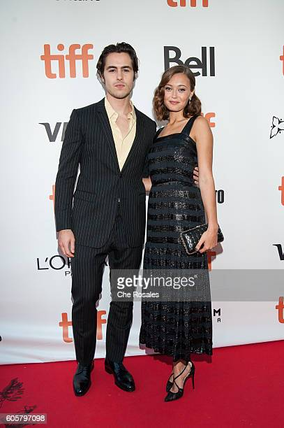 Actor Ben Schnetzer and Actress Ella Purnell attend the premiere of 'The Journey Is The Destination' at Roy Thomson Hall on September 14 2016 in...