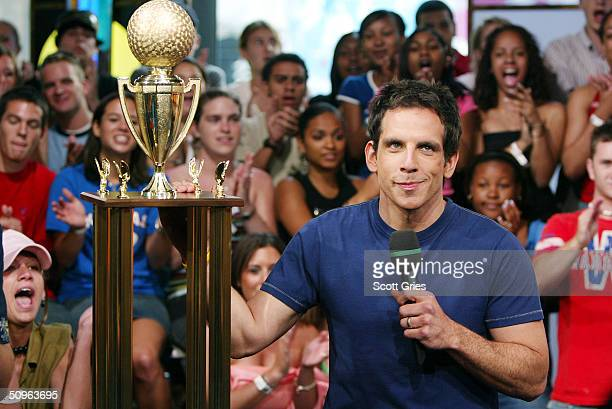 Actor Ben Stiller celebrates with his trophy he won during a dodgeball game during an appearance on MTV's Total Request Live at the MTV Times Square...