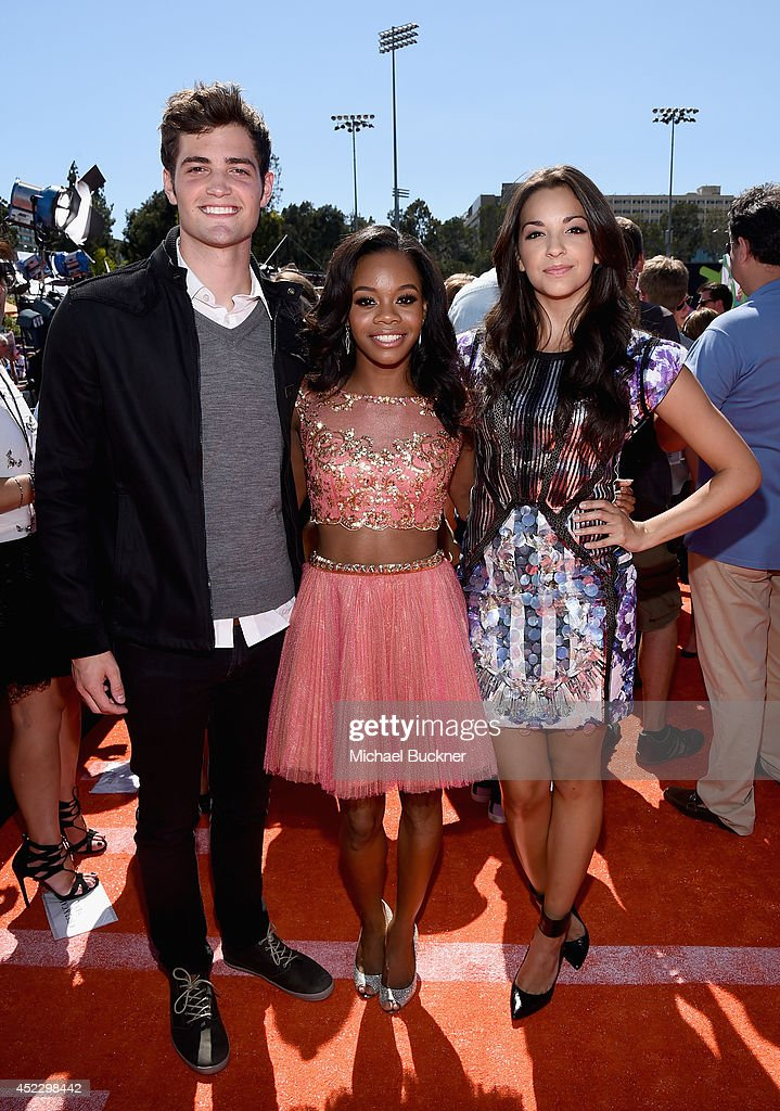 Actor Ben Winchell with Gymnast <a gi-track='captionPersonalityLinkClicked' href=/galleries/search?phrase=Gabby+Douglas&family=editorial&specificpeople=8465211 ng-click='$event.stopPropagation()'>Gabby Douglas</a> and actress <a gi-track='captionPersonalityLinkClicked' href=/galleries/search?phrase=Ana+Villafane&family=editorial&specificpeople=9757399 ng-click='$event.stopPropagation()'>Ana Villafane</a> attend Nickelodeon Kids' Choice Sports Awards 2014 at UCLA's Pauley Pavilion on July 17, 2014 in Los Angeles, California.