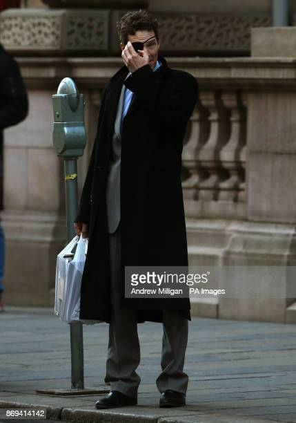 Actor Benedict Cumberbatch adjusts his eye patch during shooting scenes in Glasgow which has been transformed into New York City for the filming of...