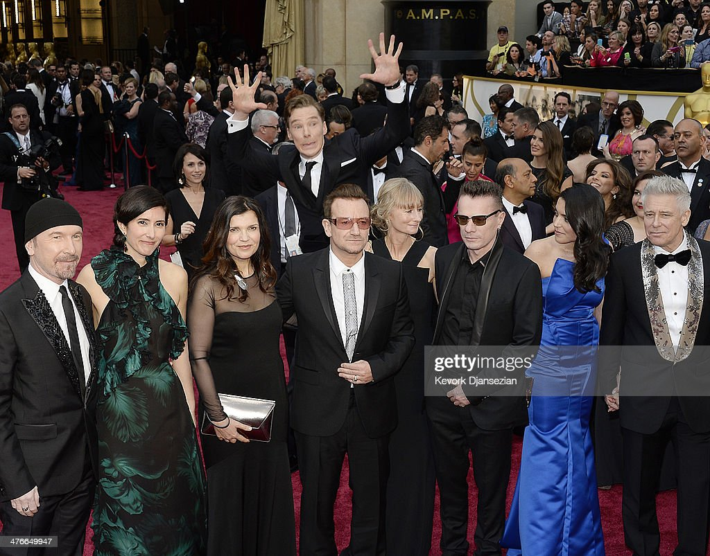 Actor <a gi-track='captionPersonalityLinkClicked' href=/galleries/search?phrase=Benedict+Cumberbatch&family=editorial&specificpeople=2487879 ng-click='$event.stopPropagation()'>Benedict Cumberbatch</a> photo bombs the group photo of (L-R) musicians The Edge, <a gi-track='captionPersonalityLinkClicked' href=/galleries/search?phrase=Bono+-+Singer&family=editorial&specificpeople=167279 ng-click='$event.stopPropagation()'>Bono</a>, Larry Mullen, Jr. and <a gi-track='captionPersonalityLinkClicked' href=/galleries/search?phrase=Adam+Clayton+-+Musician&family=editorial&specificpeople=204667 ng-click='$event.stopPropagation()'>Adam Clayton</a> of U2 as they arrive for the 86th Annual Academy Awards held at Hollywood & Highland Center on March 2, 2014 in Hollywood, California.