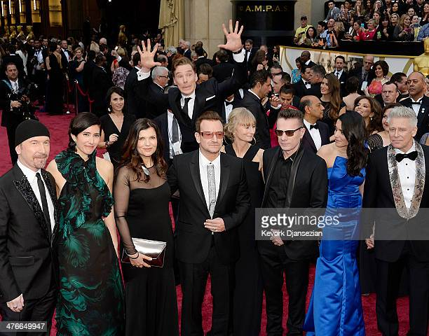 Actor Benedict Cumberbatch photo bombs the group photo of musicians The Edge Bono Larry Mullen Jr and Adam Clayton of U2 as they arrive for the 86th...