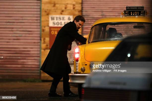 Actor Benedict Cumberbatch shooting scenes in Glasgow's famous Barras market which has been transformed into New York City for the filming of the TV...