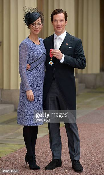 Actor Benedict Cumberbatch with his wife Sophie Hunter after receiving the CBE from Queen Elizabeth II for services to the performing arts and to...