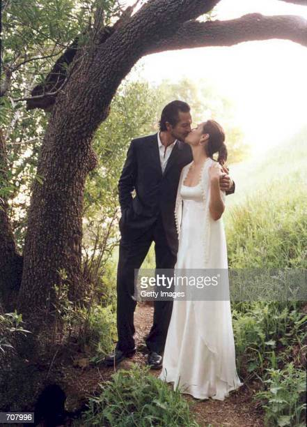 Actor Benjamin Bratt and actress Talisa Soto kiss on their wedding day April 13 2002 in San Francisco CA Bratt former boyfriend of actress Julia...