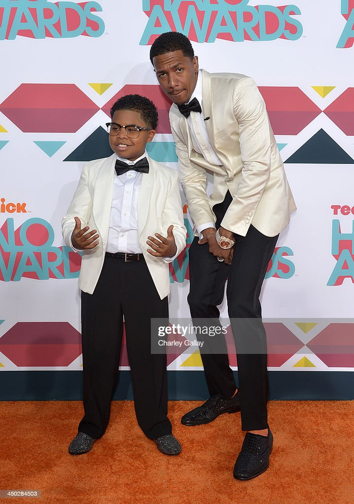 Actor Benjamin 'Lil P-Nut' Flores Jr. (L) and host <a gi-track='captionPersonalityLinkClicked' href=/galleries/search?phrase=Nick+Cannon&family=editorial&specificpeople=202208 ng-click='$event.stopPropagation()'>Nick Cannon</a> arrive at the 5th Annual TeenNick HALO Awards at Hollywood Palladium on November 17, 2013 in Hollywood, California.