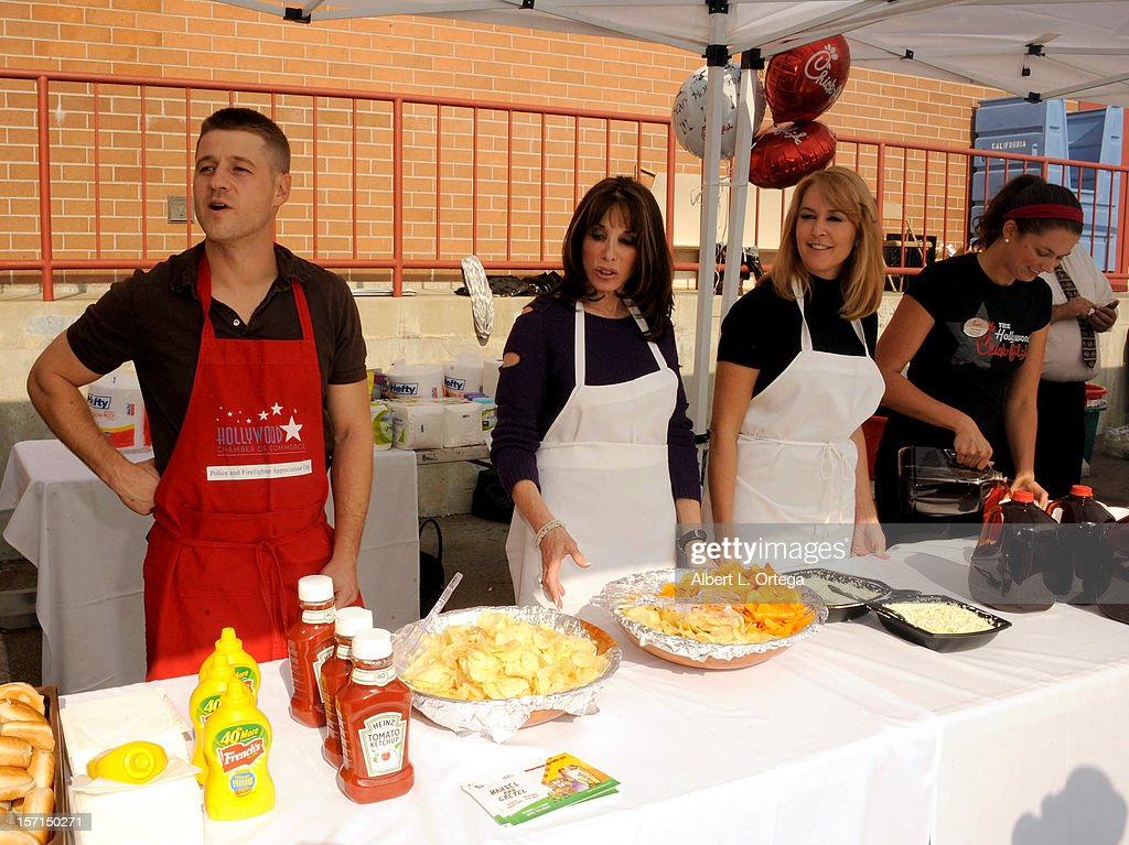 Actor Benjamin McKenzie, actress Kate Linder and actress Erin Murphy participate in the Hollywood Chamber of Commerce's annual police and firefighters appreciation day at the Hollywood LAPD station on November 28, 2012 in Hollywood, California.