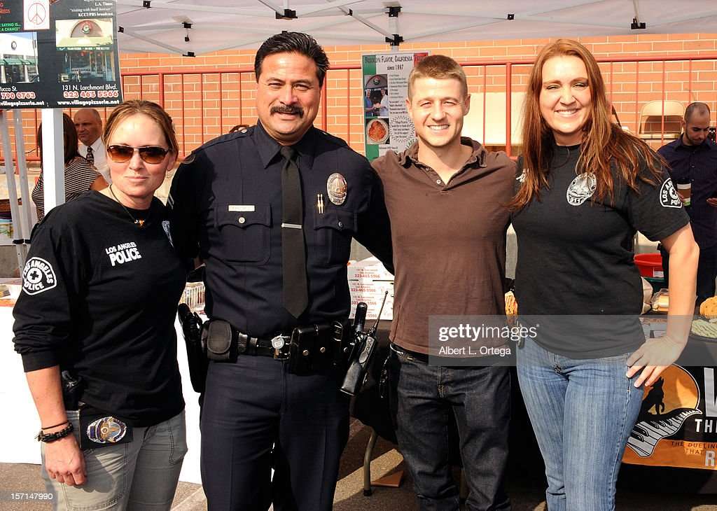 Actor <a gi-track='captionPersonalityLinkClicked' href=/galleries/search?phrase=Benjamin+McKenzie&family=editorial&specificpeople=213315 ng-click='$event.stopPropagation()'>Benjamin McKenzie</a> participates in the Hollywood Chamber of Commerce's annual police and firefighters appreciation day at the Hollywood LAPD station on November 28, 2012 in Hollywood, California.