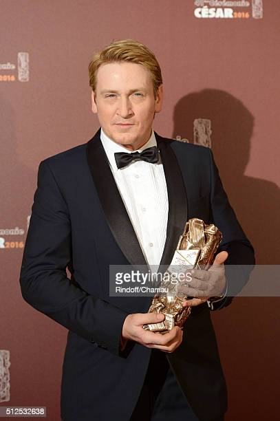 Actor Benoit Magimel poses with his award of Best actor in a supporting role for the movie 'La Tete Haute' during The Cesar Film Awards 2016 at...