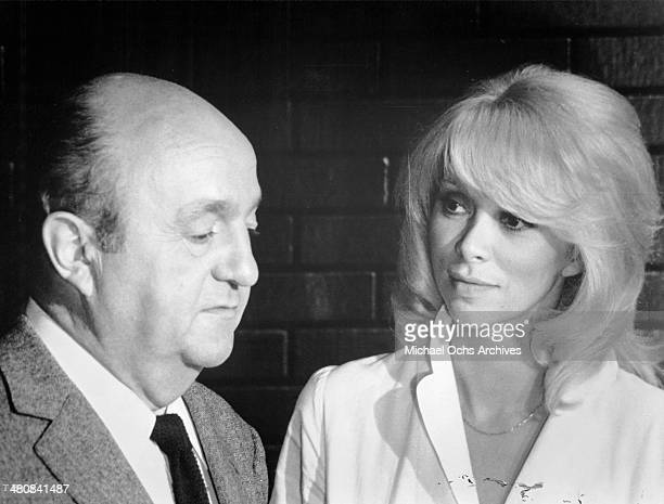 Actor Bernard Blier and actress Mireille Darc in a scene from the French movie 'The Tall Blond Man with One Black Shoe' circa 1972