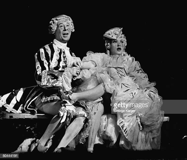 Actor Bert Lahr as Louis XV rapsodizing over the lushousness of actress Betty Grable as a Court of Versailles cortesan after kissing her foot in the...