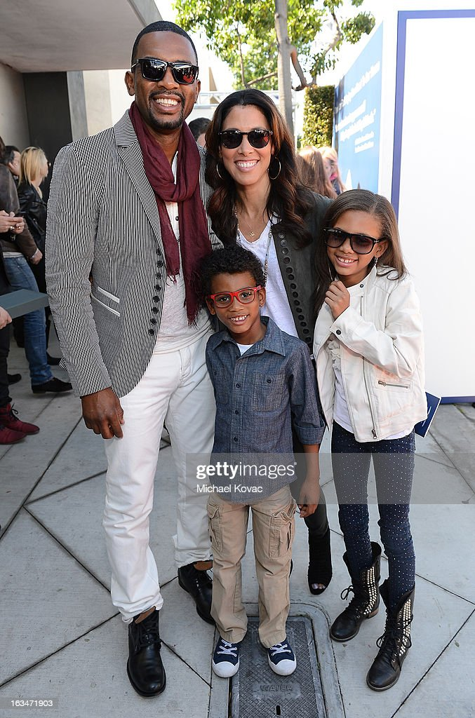 Actor Bill Bellamy and Kristen Bellamy, Bailey Ivory-Rose Bellamy, and Baron Bellamy wearing John Varvatos Eyewear at the 10th Annual Stuart House Benefit presented by Chrysler at John Varvatos Los Angeles on March 10, 2013 in Los Angeles, California.