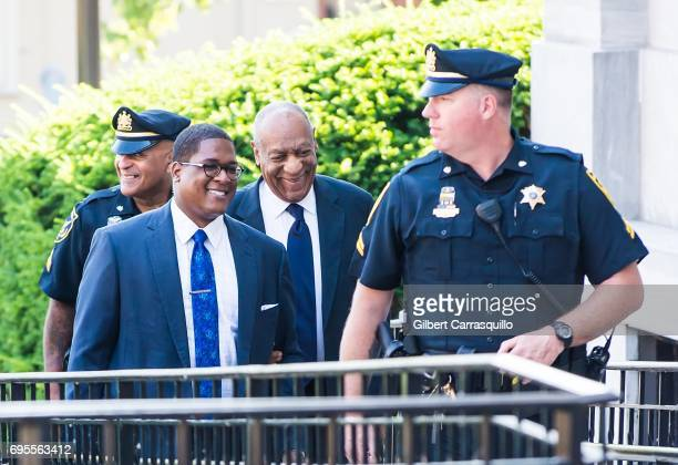 Actor Bill Cosby arrives at Montgomery County Courthouse with Andrew Wyatt as his trial continues on June 13 2017 in Norristown Pennsylvania