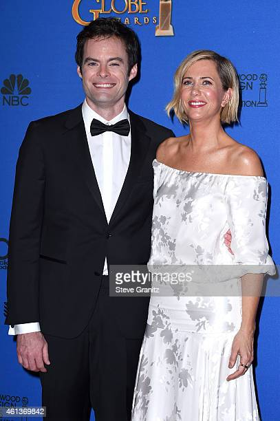 Actor Bill Hader and actress Kristen Wiig pose in the press room during the 72nd Annual Golden Globe Awards at The Beverly Hilton Hotel on January 11...