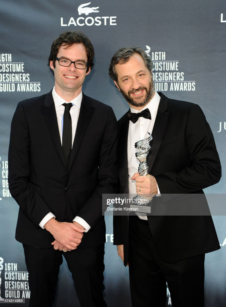 Actor <a gi-track='captionPersonalityLinkClicked' href=/galleries/search?phrase=Bill+Hader&family=editorial&specificpeople=757145 ng-click='$event.stopPropagation()'>Bill Hader</a> (L) and director/writer <a gi-track='captionPersonalityLinkClicked' href=/galleries/search?phrase=Judd+Apatow&family=editorial&specificpeople=854225 ng-click='$event.stopPropagation()'>Judd Apatow</a> attend the 16th Costume Designers Guild Awards with presenting sponsor Lacoste at The Beverly Hilton Hotel on February 22, 2014 in Beverly Hills, California.