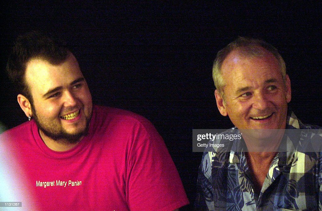 Actor Bill Murray (R) and his son Homer Murray pause to have their picture taken as they arrive for the Free Arts for Abused Children's 3rd annual Art Auction benefit July 17, 2002 in New York City. The event auctions off the images created by artists and celebrities to raise funds for the nonprofit outreach program for abused kids.