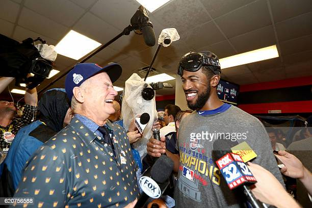 Actor Bill Murray celebrates in the clubhouse with Dexter Fowler of the Chicago Cubs after the Cubs defeated the Cleveland Indians 87 in Game Seven...