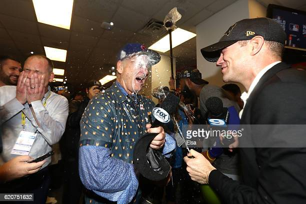 Actor Bill Murray celebrates in the clubhouse with President of Baseball Operations for the Chicago Cubs Theo Epstein after the Cubs defeated the...