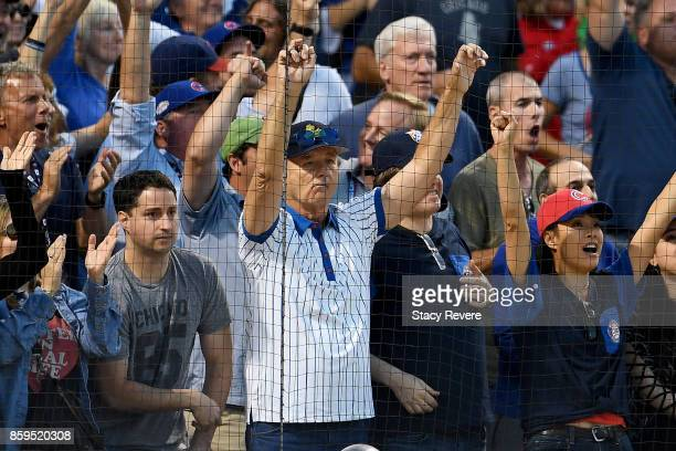 Actor Bill Murray cheers during game three of the National League Division Series between the Washington Nationals and the Chicago Cubs at Wrigley...