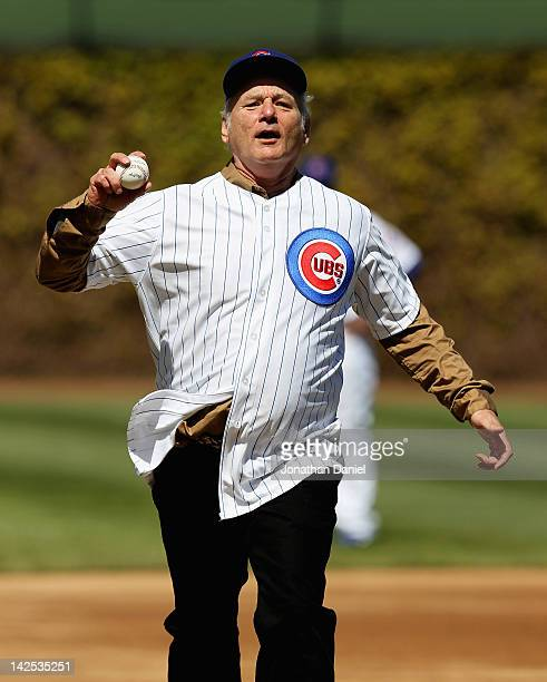 Actor Bill Murray runs the bases before throwing out a ceremonial first pitch before the Chicago Cubs take on the Washington Nationals during the...
