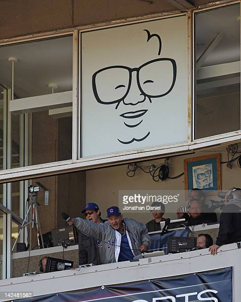 Actor Bill Murray sings 'Take Me Out to the Ball Game' during the 7th inning stretch of the opening day game between the Chicago Cubs and the...