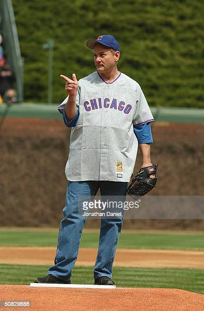 Actor Bill Murray stands on the mound as he prepares to throw the ceremonial first pitch prior to the Chicago Cubs home opener against the Pittsburgh...
