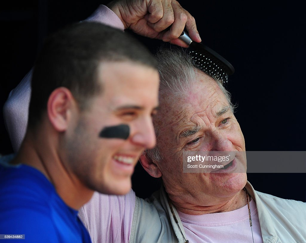 Actor Bill Murray visits with Anthony Rizzo of the Chicago Cubs before the game against the Atlanta Braves at Turner Field on June 11 2016 in Atlanta...